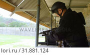 Купить «Side view of young caucasian military soldier loading rifle during military training 4k», видеоролик № 31881124, снято 27 июня 2018 г. (c) Wavebreak Media / Фотобанк Лори