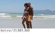 Купить «Romantic couple walking together at beach 4k», видеоролик № 31881360, снято 14 ноября 2018 г. (c) Wavebreak Media / Фотобанк Лори
