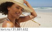 Купить «Woman relaxing in hammock with hat at beach 4k», видеоролик № 31881632, снято 14 ноября 2018 г. (c) Wavebreak Media / Фотобанк Лори