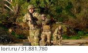 Купить «Front view of military soldiers training during military training 4k», видеоролик № 31881780, снято 27 июня 2018 г. (c) Wavebreak Media / Фотобанк Лори