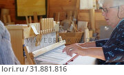 Купить «Side view of old caucasian senior woman weaving cloth on handloom machine in a workshop 4k», видеоролик № 31881816, снято 10 ноября 2017 г. (c) Wavebreak Media / Фотобанк Лори