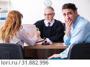 Купить «Young couple in the courthouse in divorce concept», фото № 31882996, снято 28 марта 2019 г. (c) Elnur / Фотобанк Лори