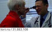 Купить «Side view of young Asian male doctor examining a senior patient in the clinic 4k», видеоролик № 31883108, снято 25 ноября 2018 г. (c) Wavebreak Media / Фотобанк Лори