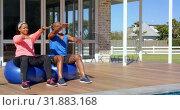 Купить «Mixed race mature couple exercising together on exercise ball  at backyard on a sunny day 4k», видеоролик № 31883168, снято 7 ноября 2018 г. (c) Wavebreak Media / Фотобанк Лори