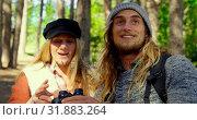 Купить «Young couple camping in the forest on a sunny day 4k», видеоролик № 31883264, снято 12 октября 2018 г. (c) Wavebreak Media / Фотобанк Лори