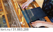 Купить «High angle view of old caucasian senior woman weaving cloth on handloom machine in a workshop 4k», видеоролик № 31883288, снято 10 ноября 2017 г. (c) Wavebreak Media / Фотобанк Лори
