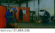 Купить «Time lapse of workers using grinder and welding torch in workshop 4k», видеоролик № 31884336, снято 4 октября 2018 г. (c) Wavebreak Media / Фотобанк Лори