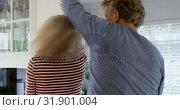 Купить «Side view of mature caucasian couple dancing together in kitchen at home 4k», видеоролик № 31901004, снято 25 мая 2018 г. (c) Wavebreak Media / Фотобанк Лори