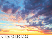 Купить «Heavenly summer background. Beautiful bright majestic dramatic evening sky at sunset or sunrise orange and blue with rays. The sun shines over the horizon against the backdrop of thunder clouds», фото № 31901132, снято 28 июня 2019 г. (c) Светлана Евграфова / Фотобанк Лори