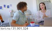 Купить «Young multi ethnic business executives working on laptop at desk 4k», видеоролик № 31901324, снято 18 ноября 2018 г. (c) Wavebreak Media / Фотобанк Лори
