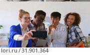 Купить «Young multi-ethnic business colleagues taking selfie with mobile phone in modern office 4k», видеоролик № 31901364, снято 18 ноября 2018 г. (c) Wavebreak Media / Фотобанк Лори