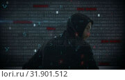 Купить «Hacker using computer in dark room with digital code », видеоролик № 31901512, снято 22 января 2019 г. (c) Wavebreak Media / Фотобанк Лори
