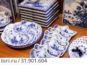 Купить «Dishes with traditional blue Dutch paintings», фото № 31901604, снято 25 февраля 2017 г. (c) EugeneSergeev / Фотобанк Лори