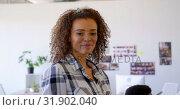 Купить «Pretty mixed-race female executive using digital tablet in modern office 4k», видеоролик № 31902040, снято 18 ноября 2018 г. (c) Wavebreak Media / Фотобанк Лори