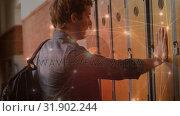 Купить «Student man opening his locker at school », видеоролик № 31902244, снято 22 января 2019 г. (c) Wavebreak Media / Фотобанк Лори