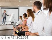Купить «Side view of students with laptops», фото № 31902364, снято 25 июля 2018 г. (c) Яков Филимонов / Фотобанк Лори