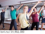 Beginner dancers learning zumba elements in dancing hall. Стоковое фото, фотограф Яков Филимонов / Фотобанк Лори