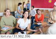Купить «Students communicating during recess between lectures», фото № 31902396, снято 22 сентября 2019 г. (c) Яков Филимонов / Фотобанк Лори