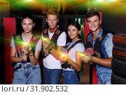 Купить «Group portrait of adult people with laser guns», фото № 31902532, снято 23 августа 2018 г. (c) Яков Филимонов / Фотобанк Лори