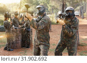 Купить «Cheerful men in camouflage holding guns ready for playing paintb», фото № 31902692, снято 22 сентября 2018 г. (c) Яков Филимонов / Фотобанк Лори