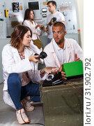 Купить «Girl and guy checking telephone set in escape room», фото № 31902792, снято 8 октября 2018 г. (c) Яков Филимонов / Фотобанк Лори