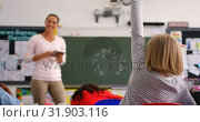 Купить «Rear view of schoolgirl raising hand in the classroom 4k», видеоролик № 31903116, снято 17 ноября 2018 г. (c) Wavebreak Media / Фотобанк Лори