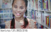 Купить «schoolgirl holding stack of book in library at school», видеоролик № 31903516, снято 22 января 2019 г. (c) Wavebreak Media / Фотобанк Лори