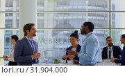 Купить «Multi ethnic business people interacting with each other during a seminar 4k», видеоролик № 31904000, снято 21 ноября 2018 г. (c) Wavebreak Media / Фотобанк Лори