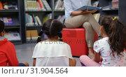 Купить «Female teacher teaching schoolkids in the school library 4k», видеоролик № 31904564, снято 17 ноября 2018 г. (c) Wavebreak Media / Фотобанк Лори
