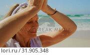 Купить «Front view of active senior Caucasian woman performing yoga on the beach 4k», видеоролик № 31905348, снято 14 ноября 2018 г. (c) Wavebreak Media / Фотобанк Лори
