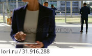 Купить «Mixed-race businessman phoning in the lobby at office 4k», видеоролик № 31916288, снято 21 ноября 2018 г. (c) Wavebreak Media / Фотобанк Лори
