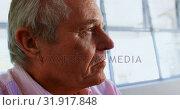 Close-up of active Caucasian senior man relaxing at nursing home 4k. Стоковое видео, агентство Wavebreak Media / Фотобанк Лори