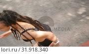 Купить «High angle view of African American woman jogging in the city 4k», видеоролик № 31918340, снято 5 декабря 2018 г. (c) Wavebreak Media / Фотобанк Лори