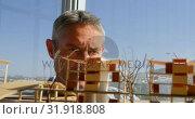 Купить «Front view of Caucasian male architects looking at building model in office 4k», видеоролик № 31918808, снято 18 ноября 2018 г. (c) Wavebreak Media / Фотобанк Лори