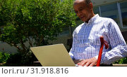 Купить «Front view of active Asian senior man using laptop in the garden of nursing home 4k», видеоролик № 31918816, снято 22 ноября 2018 г. (c) Wavebreak Media / Фотобанк Лори
