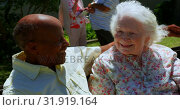 Front view of active mixed-race senior couple embracing each other in the garden of nursing home 4k. Стоковое видео, агентство Wavebreak Media / Фотобанк Лори