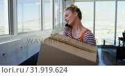 Купить «Front view of Caucasian Businesswoman talking on mobile phone in the office 4k», видеоролик № 31919624, снято 18 ноября 2018 г. (c) Wavebreak Media / Фотобанк Лори