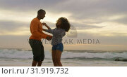 Купить «Side view of African american couple embracing each other on the beach 4k», видеоролик № 31919732, снято 12 ноября 2018 г. (c) Wavebreak Media / Фотобанк Лори