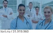 Купить «Medical team posing for the camera», видеоролик № 31919960, снято 5 марта 2019 г. (c) Wavebreak Media / Фотобанк Лори
