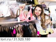 Купить «Customer woman in lingerie shop», фото № 31920180, снято 20 марта 2017 г. (c) Яков Филимонов / Фотобанк Лори