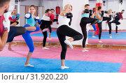 Купить «women are boxing and doing kick with coach», фото № 31920220, снято 8 октября 2017 г. (c) Яков Филимонов / Фотобанк Лори