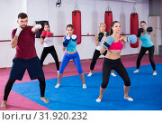 group females and their trainer are boxing in gym. Стоковое фото, фотограф Яков Филимонов / Фотобанк Лори