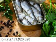 Купить «Sardines in oil with parsley, lemon and spices», фото № 31920320, снято 22 августа 2019 г. (c) Яков Филимонов / Фотобанк Лори