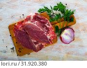 Купить «Raw pork chop on cutting board», фото № 31920380, снято 24 августа 2019 г. (c) Яков Филимонов / Фотобанк Лори