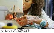 Купить «Front view of African American female fashion designer working with sewing machine in workshop 4k», видеоролик № 31920528, снято 18 ноября 2018 г. (c) Wavebreak Media / Фотобанк Лори