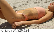Купить «Side view of Caucasian woman in hat relaxing on the beach 4k», видеоролик № 31920624, снято 12 ноября 2018 г. (c) Wavebreak Media / Фотобанк Лори