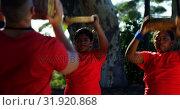 Купить «Male trainer training kids in the boot camp on a sunny day 4k», видеоролик № 31920868, снято 16 марта 2017 г. (c) Wavebreak Media / Фотобанк Лори