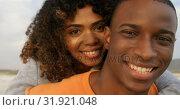 Купить «Front view of African American couple embracing each other on the beach 4k», видеоролик № 31921048, снято 12 ноября 2018 г. (c) Wavebreak Media / Фотобанк Лори