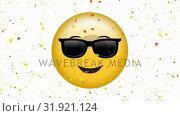 Купить «Smiling face with sunglasses emoji», видеоролик № 31921124, снято 5 марта 2019 г. (c) Wavebreak Media / Фотобанк Лори