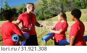 Купить «Male trainer interacting with kids in the boot camp 4k», видеоролик № 31921308, снято 16 марта 2017 г. (c) Wavebreak Media / Фотобанк Лори